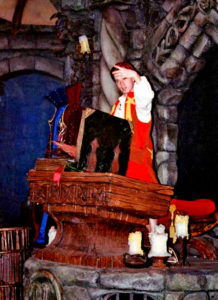 Opening Nostramos' book of spells (Dan Walsh as Northrup - Photo courtesy of CastleOSullivan / Tyler Whitby)